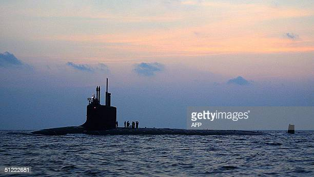 This photo released by the US NAvy 25 August shows the newest and most advanced nuclear-powered attack submarine PCU Virginia travelling from...