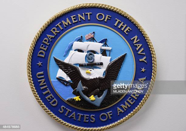 This photo reviewed by the US military shows the United States Department of the Navy emblem hanging on a wall at the Joint Detention Forces...