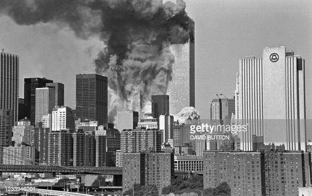 This photo shot onSeptember 11, 2001 shows the south tower of the World Trade Center in New York collapsing. - Rescue efforts continue at the World...