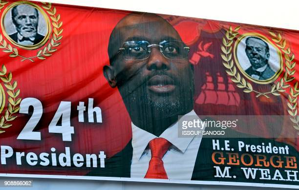 This photo shows a banner featuring a portrait of Liberia's new president George Weah after his inauguration on January 22 2018 in Monrovia To the...