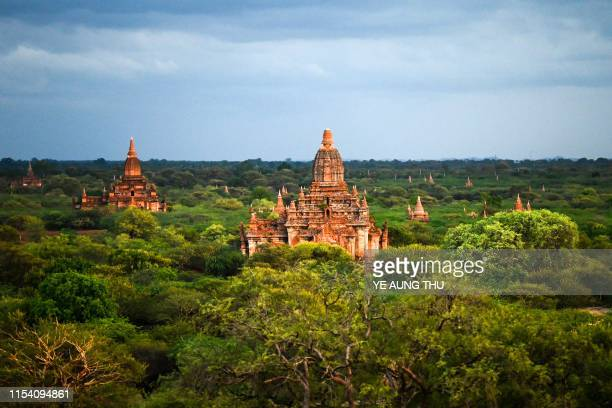 TOPSHOT This photo shows a general view of ancient pagodas in Bagan on July 6 2019 The UNESCO World Heritage Committee on July 6 approved the...