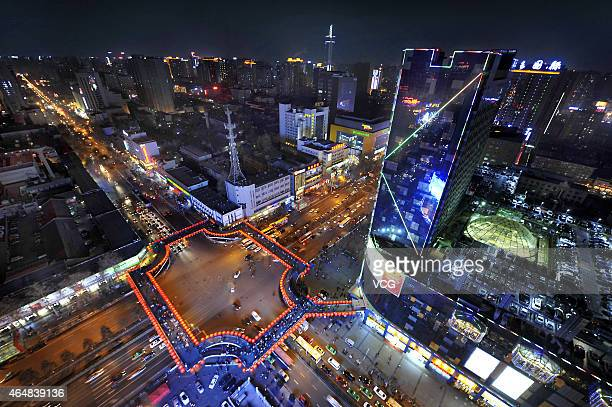 This photo shows a night view of roof parking lot at SEG Plaza on February 28 2015 in Xi'an Shaanxi province of China A roof parking lot with spaces...