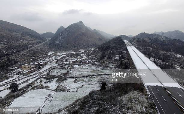 This photo shows a part of a highway closed due to cold and snow in Shaoguan south China's Guangdong province on January 24 2016 Much of China...