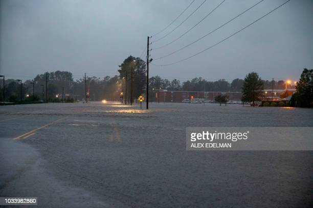 TOPSHOT This photo shows a road submerged in floodwater in Lumberton North Carolina on September 15 2018 in the wake of Hurricane Florence Besides...