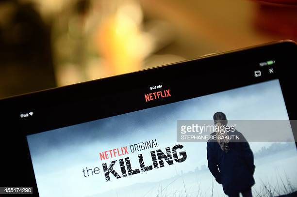 This photo shows a television screen displaying the French user interface of US online streaming giant Netflix on September 15 2014 in Paris US...