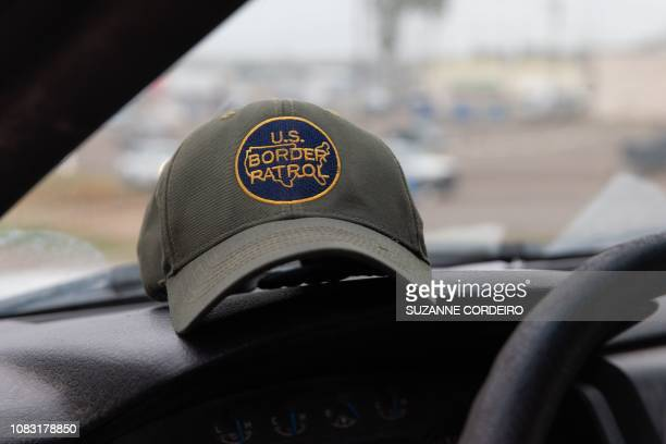 This photo shows a US Border Patrol hat sitting on dashboard of a Customs and Border Protection vehicle in McAllen, Texas, on January 15, 2019.