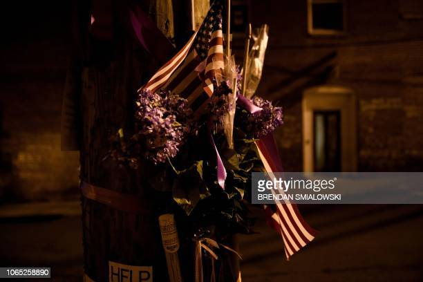 This photo shows a US flag a makeshift memorial to those injured and to Heather Heyer who was killed when James Fields drove into a crowd of...