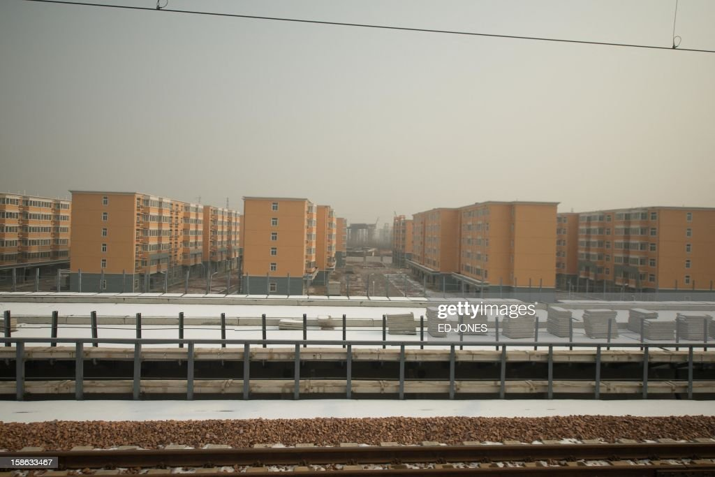 This photo shows a view from the window of a high-speed train during a journey organised for journalists to showcase a newly-built section of track through Hebei province, south of Beijing on December 22, 2012. China was showing off to the media the final link of the world's longest high-speed rail route, set to open on December 26, stretching from Beijing to the southern Chinese city of Guangzhou. Travelling at around 300 kph, trains on the new route are expected to cover the 2,298-kilometre (1,425-mile) journey in a third of the current time from 22 hours to eight. AFP PHOTO / Ed Jones