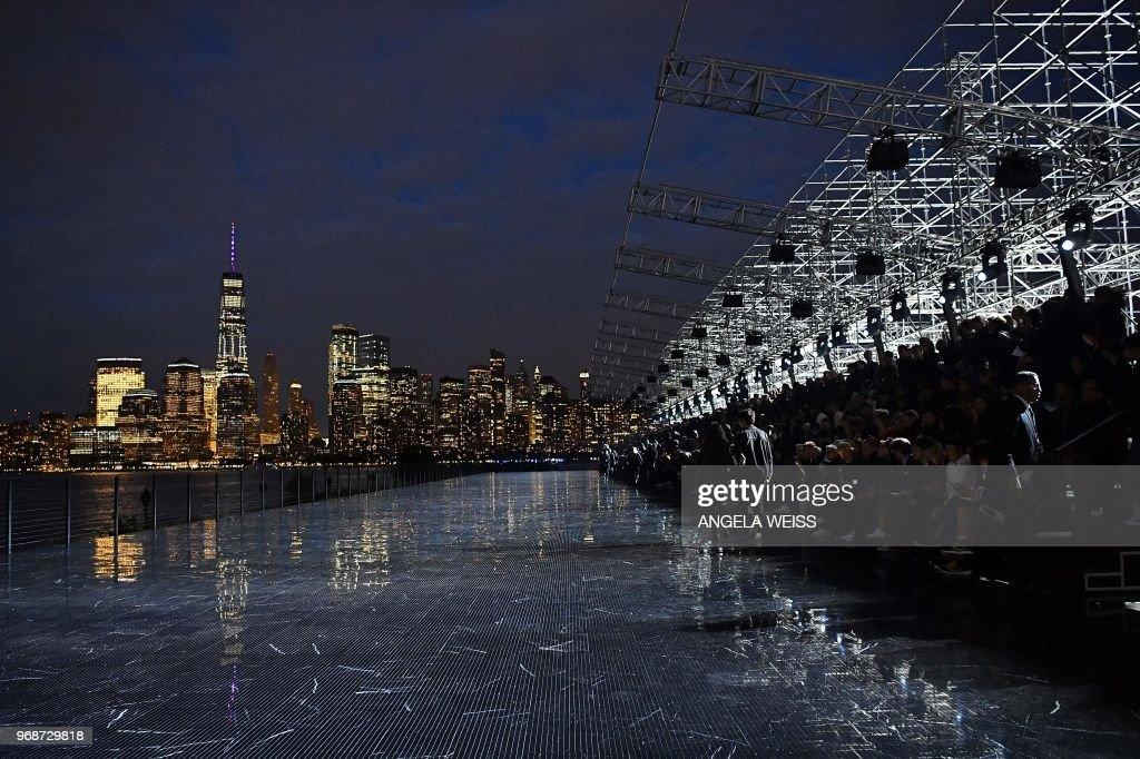 TOPSHOT - This photo shows a view of the runway and the Manhattan skyline before the Saint Laurent Men's Spring/Summer 2019 collection during a runway show in Liberty State Park on June 6, 2018 in Jersey City, New Jersey.
