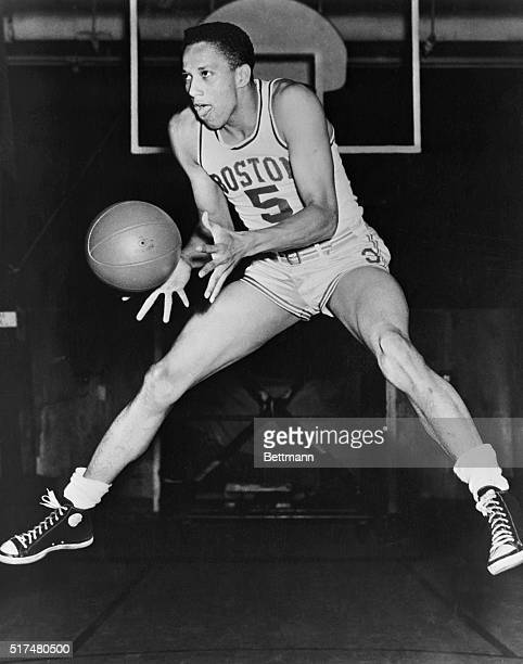 This photo shows Boston Celtic's Chuck Cooper jumping up to catch the basketball