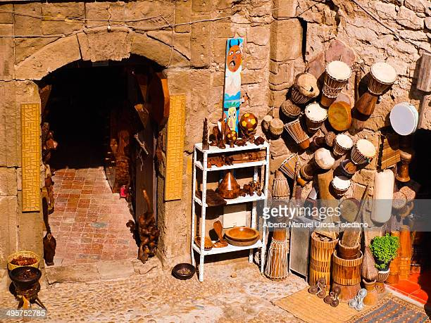 This photo shows diferent kinds of handcraft typical for Morroco - wooden handcraft, sculptures, drums,tambourines,cymbals, etc.