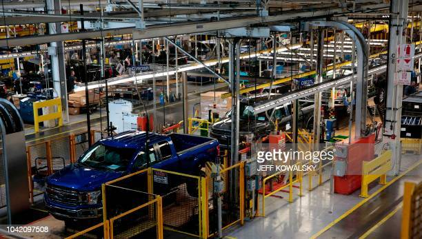This photo shows Ford 2018 and 2019 F150 trucks on the assembly line at the Ford Motor Company's Rouge Complex on September 27 2018 in Dearborn...