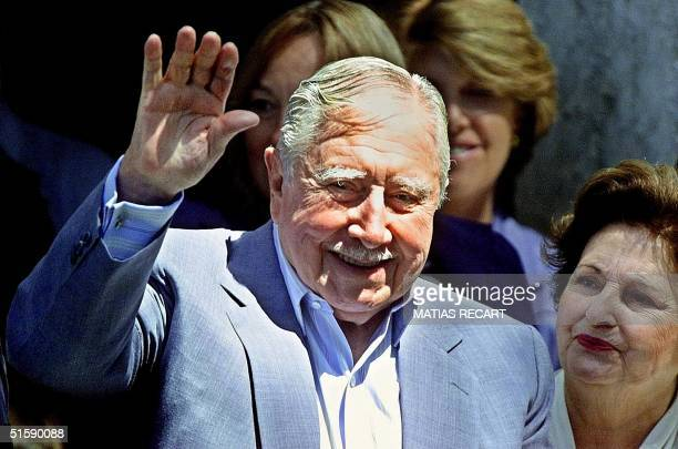 This photo shows former Chilean dictator Augusto Pinochet, next to Lucia Hiriart, greeting supporters in his Los Bolodos residence in Bucalemu,...