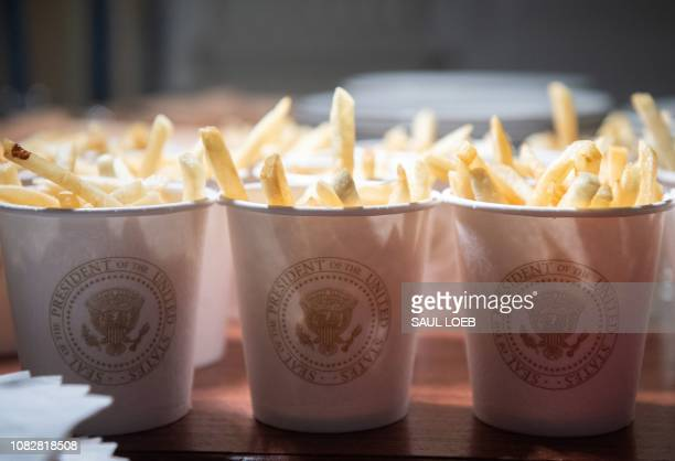 This photo shows French fries placed inside Presidential cups some of the fast food the US president purchased for a ceremony honoring the 2018...