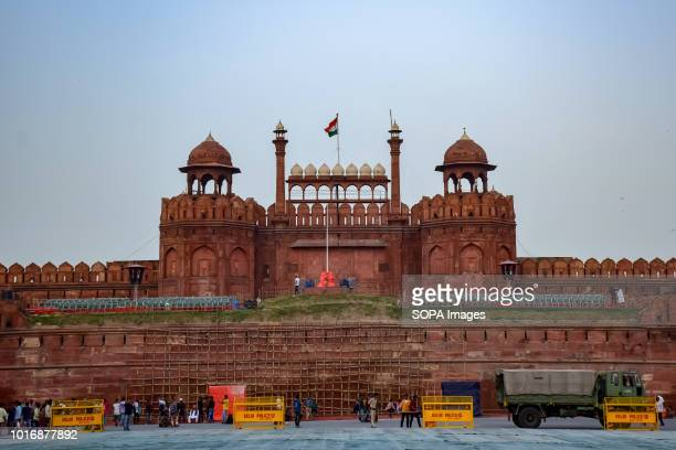 This photo shows front view of the Red Fort with the Indian Tricolour flag waving at its Centre in India's centre Delhi Built from red sandstone...