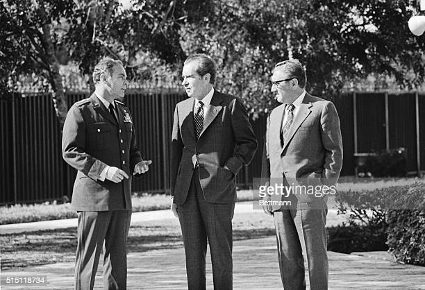 This photo shows General Alexander Haig Jr and Henry Kissinger with Richard Nixon outside Nixon's Key Biscayne home The Florida White House announced...