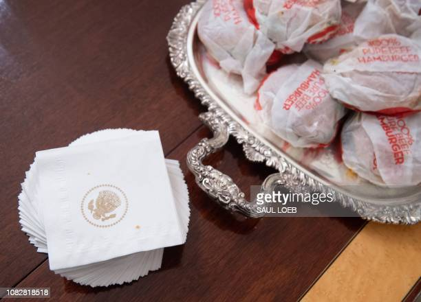 This photo shows hamburgers some of the fast food the US president purchased for a ceremony honoring the 2018 College Football Playoff National...
