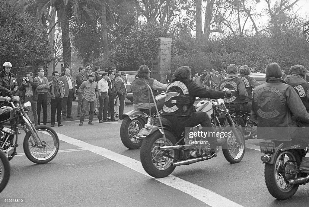 This photo shows Hell's Angels motorcyclists rounding a corner on their motorcycles.