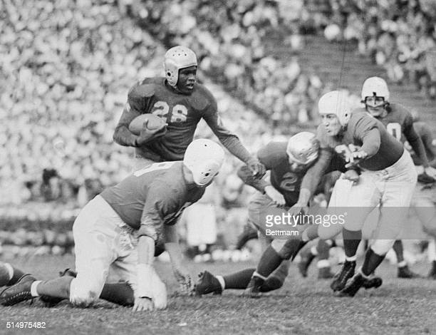 This photo shows Jackie Robinson of the Brooklyn Dodgers as a football player with U