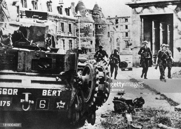 This photo shows one of the Canadian tanks used by the Commandos in their recent attack on German held Dieppe that had to be left behind in the...