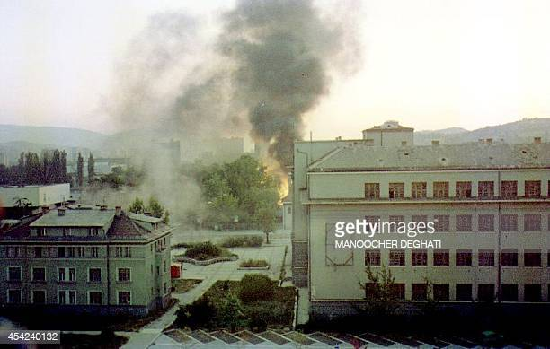 This photo shows part of the Marshal Tito Military Base burning after Serbian forces shelled Sarajevo 20 August 1992 Eight UN trucks were destroyed...