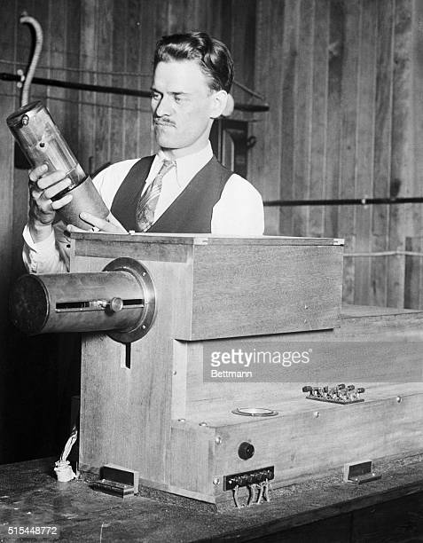 9/10/1928 This photo shows Philo T Farnsworth Utah inventor with the transmitting set of the apparatus that he recently developed for television and...