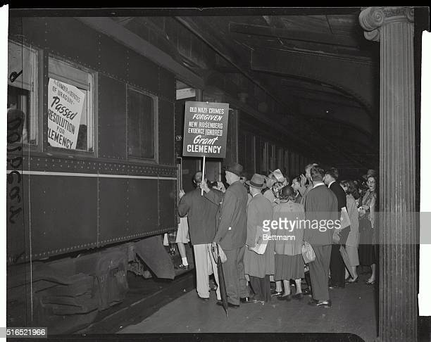 This photo shows protesters entering train for a trip to Washington DC on the B O Railroad from Jersey City They are sympathizers of Julius and Ethel...