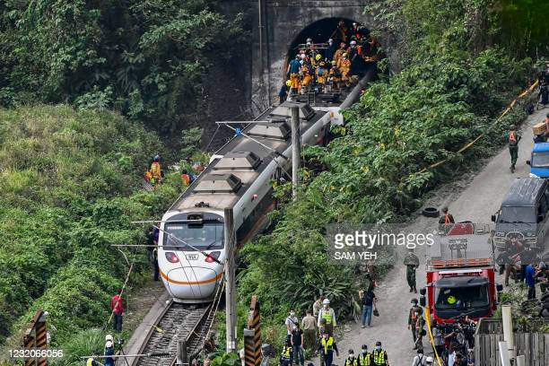 This photo shows rescue workers at the site where a train derailed inside a tunnel in the mountains of Hualien, eastern Taiwan on April 2, 2021.