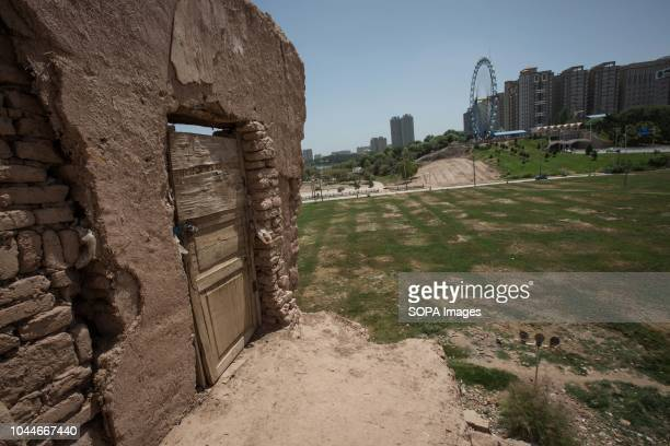 TOWN KASHGAR XINJIANG CHINA This photo shows rubble of traditional houses set to be completely demolish to make way for new homes and newly...