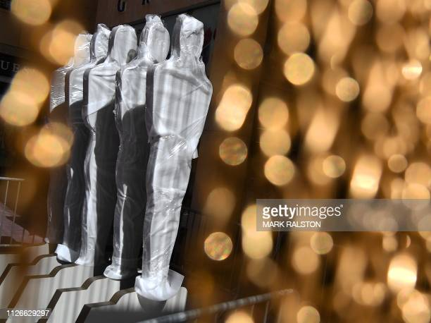 This photo shows signs shaped like Oscars statuettes on the red carpet area as preparations for the 91st Academy Awards take place in Hollywood on...