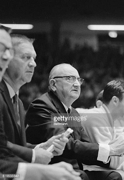 This photo shows the basketball coach Adolph Rupp of Kentucky University during a basketball game from the sidelines