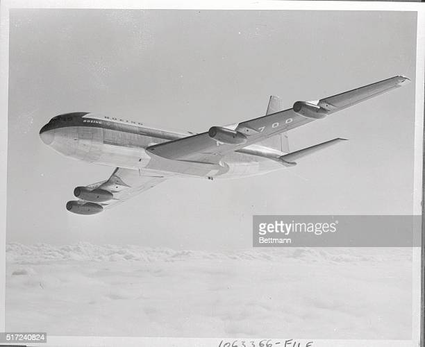 This photo shows the Boeing 707 jet prototype cruising high above the clouds during the initial phase of its flight test program It also was revealed...