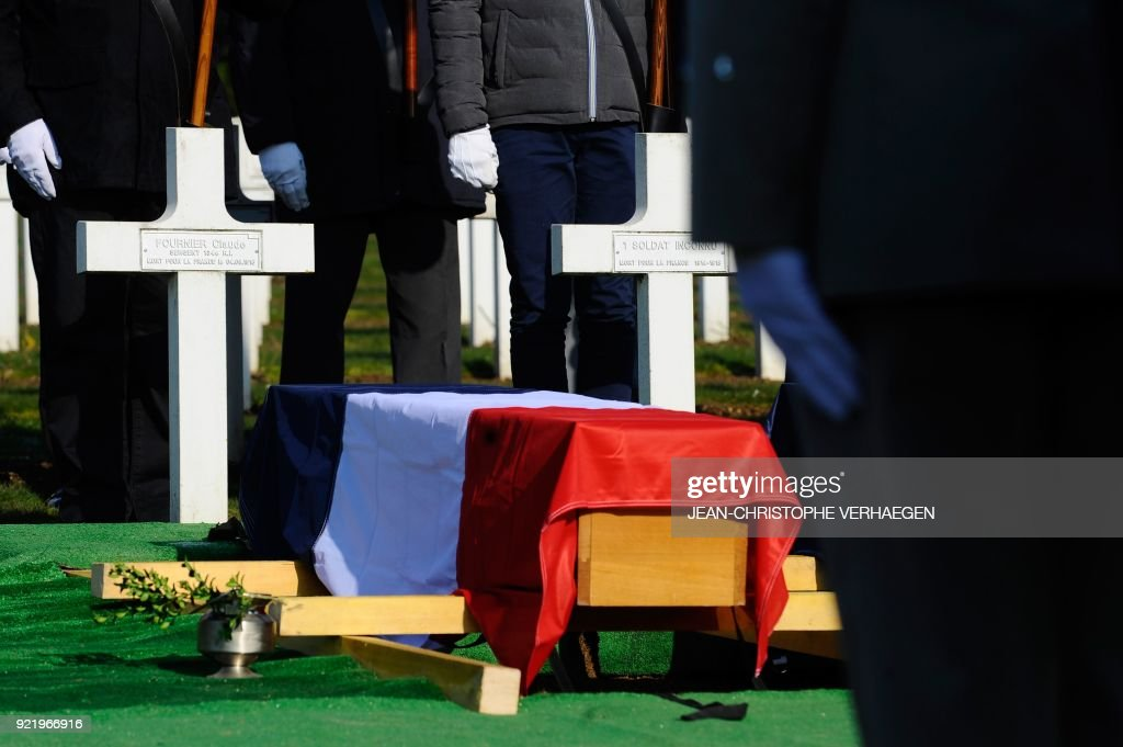 This photo shows the coffin of Sergeant Claude Fournier during the burial of three French soldiers who died during World War I in the Douaumont ossuary military cemetery in Douaumont, eastern France, on February 21, 2018. The remains were found in May 2015 during construction work at Douaumont memorial, which contains the remains of soldiers who died during the 10-month scorched-earth battle between French and German forces. The body of Sergeant Claude Fournier was identified by DNA samples from his relatives. /