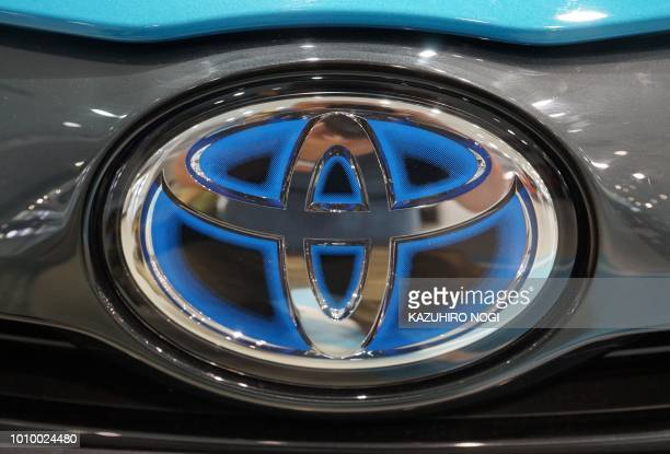 This photo shows the emblem of Toyota Motor at a showroom in Tokyo on August 3 2018 Japanese car giant Toyota on August 3 said its first quarter net...