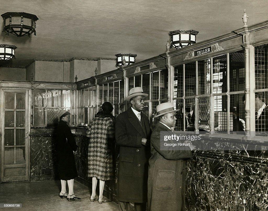 Banking Customers Standing at Bank Windows : News Photo