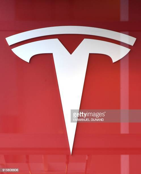 This photo shows the logo if US car maker Tesla in Brussels on February 8 2018 A day after launching one of its cars into space Tesla moved on...