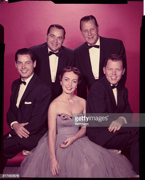 This photo shows the Modernaires, with left to right being Francis Scott, Hal Dickinson, John Drake and Allan Copeland surrounding pert, Paula Kelly.