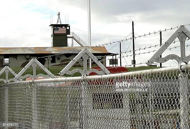 This photo shows the US naval base in Guantanamo Cuba 10 January 2002 Tras las alambradas cubanas puede verse el puesto de observacion estadounidense...