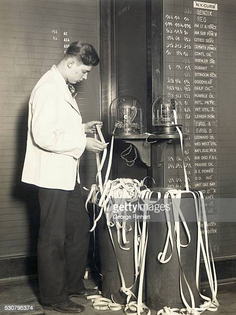 This photo shows two of the old fashioned electric tickers which are still being used in the broker's office in Chicago in spite of more modern...