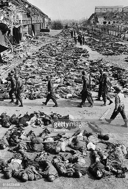 This photo shows victims at a concentration camp in Nordhausen Germany The emaciated bodies were discovered above ground and were believed to have...
