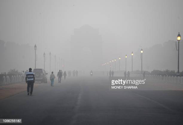 This photo take on November 2 2018 shows the India Gate monument amid heavy smog conditions in New Delhi Smog levels spike during winter in Delhi...
