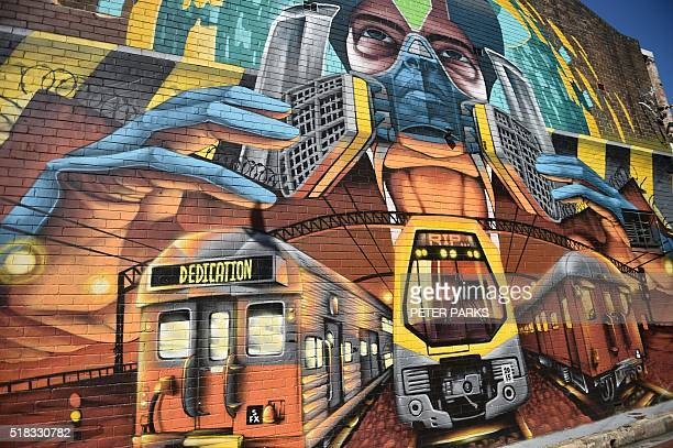 This photo takem on March 24 2016 shows the street artwork of MexicanAustralian artist Alejandro Martinez known as Peque in the suburb of St Peters...