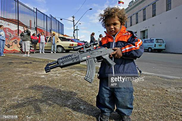 This photo taken 07 October 2007 shows an Aboriginal child playing with a toy gun in Sydney's innercity suburb of Redfern The Australian government's...