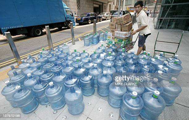 This photo taken 10 May 2006 shows water bottles left on the pavement in the Central district of Hong Kong The United Nations is set to issue 09...