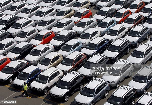 This photo taken 11 May 2007 shows rows of Hyundai Motor cars parked for shipping in the southeastern port of Ulsan. South Korea's top automaker...