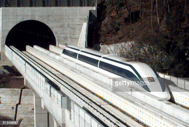 This photo taken 12 December shows an unmanned prototype magnetically levitated train on an 184kilometer special track between Tsuru and Otsuki...