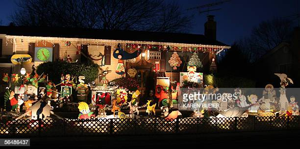 This photo taken 24 December 2005 shows the holiday display at the home of John Bonfadini in Manassas Virginia After a six year absence Santa and his...