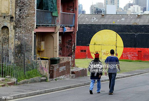 This photo taken 24 February 2004 shows two Aborigines on the street in the controversial housing area known as 'The Block' in the inner Sydney...