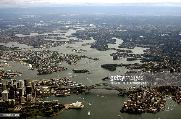 This photo taken 27 June 2007 shows the iron arch of the Sydney Harbour Bridge spanning Sydney's harbour which stretches 20 kms inland to the mouth...