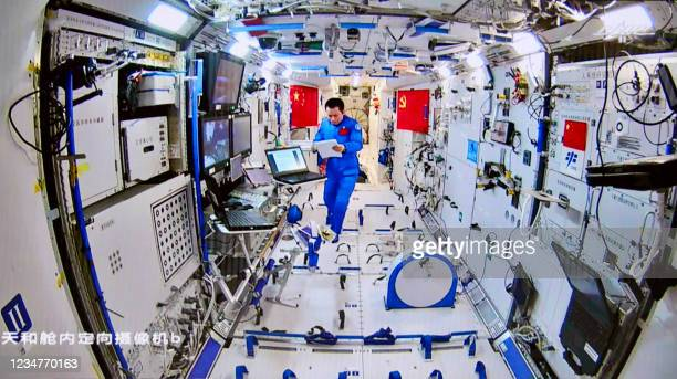 This photo taken and released on August 20, 2021 by China Manned Space Engineering Office via CNS shows Chinese astronaut Tang Hongbo coordinating...